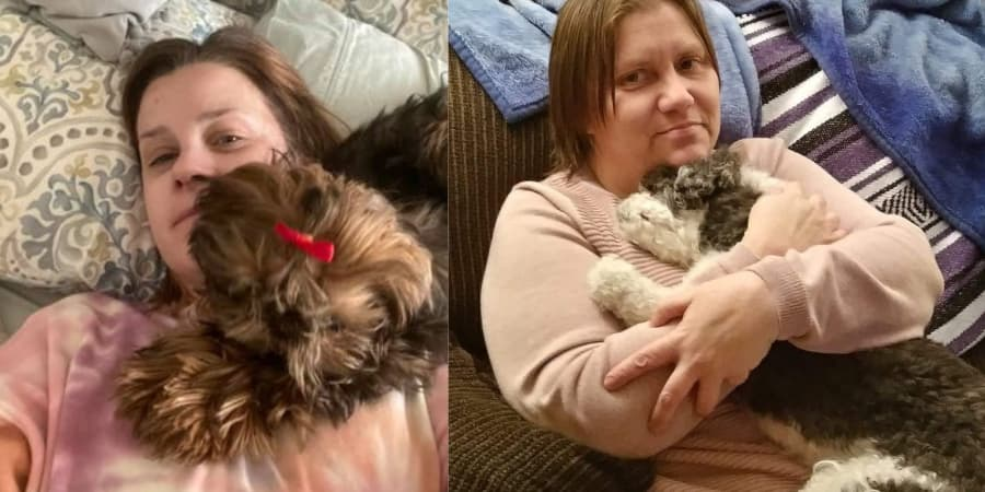 2 women holding their shih tzus cuddling with them